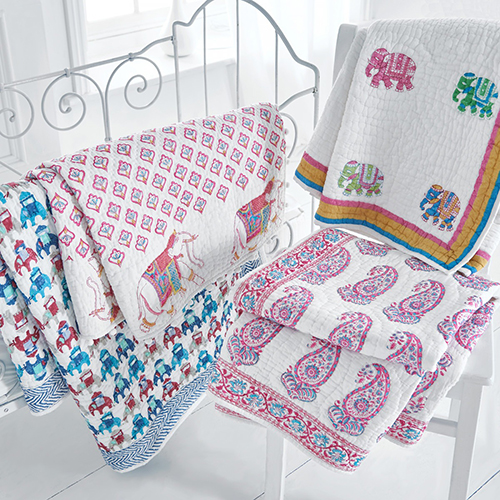 Hand blocked cot bed quilts